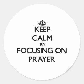 Keep Calm by focusing on Prayer Round Sticker