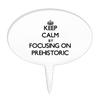 Keep Calm by focusing on Prehistoric Cake Topper
