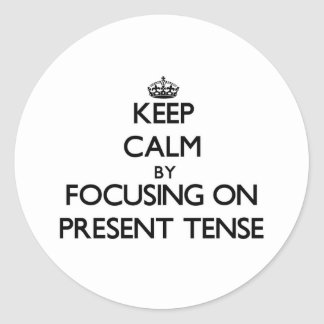 Keep Calm by focusing on Present Tense Classic Round Sticker