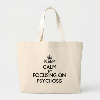 Keep Calm by focusing on Psychosis Tote Bags