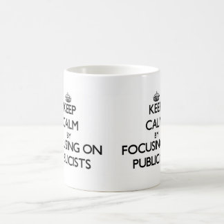 Keep Calm by focusing on Publicists Mugs