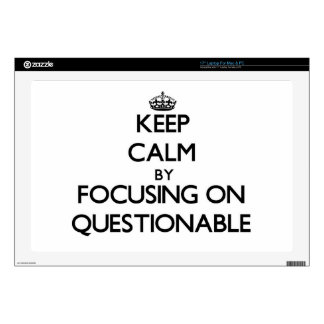 """Keep Calm by focusing on Questionable 17"""" Laptop Skins"""