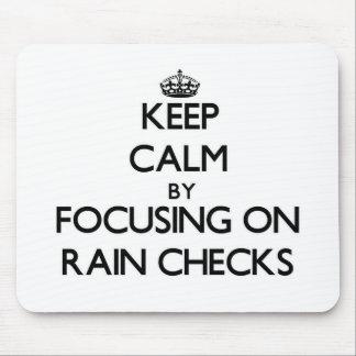 Keep Calm by focusing on Rain Checks Mouse Pad
