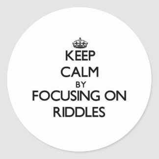 Keep Calm by focusing on Riddles Round Stickers