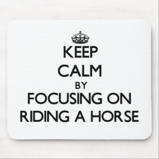 Keep Calm by focusing on Riding A Horse Mousepads
