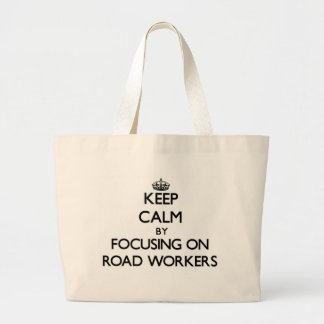 Keep Calm by focusing on Road Workers Tote Bags