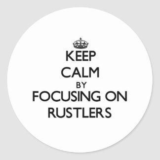 Keep Calm by focusing on Rustlers Round Stickers