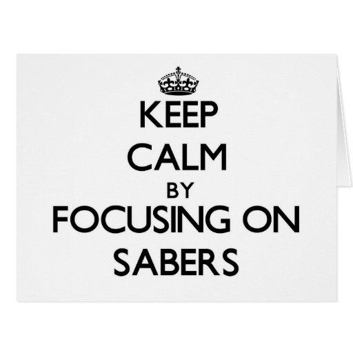 Keep Calm by focusing on Sabers Greeting Card