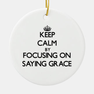 Keep Calm by focusing on Saying Grace Christmas Tree Ornament