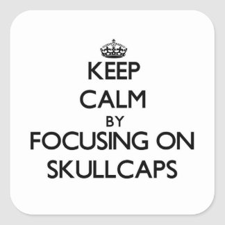 Keep Calm by focusing on Skullcaps Square Sticker