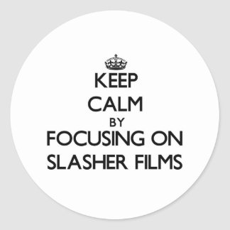 Keep Calm by focusing on Slasher Films Round Stickers