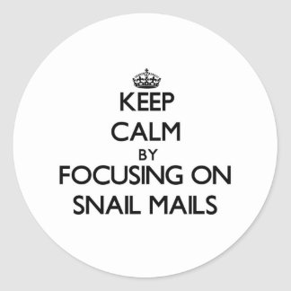 Keep Calm by focusing on Snail Mails Round Sticker