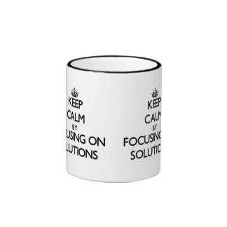 Keep Calm by focusing on Solutions Mugs