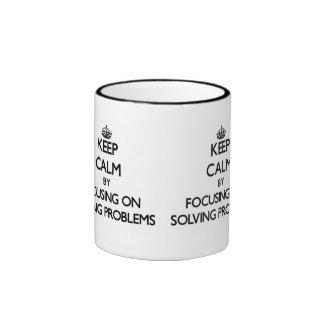 Keep Calm by focusing on Solving Problems Mug