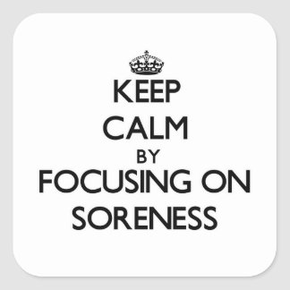 Keep Calm by focusing on Soreness Square Stickers