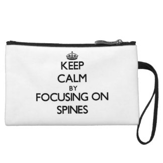 Keep Calm by focusing on Spines Wristlet Purses