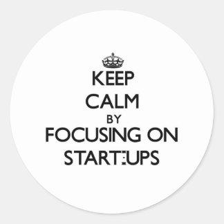 Keep Calm by focusing on Start-Ups Round Sticker