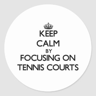 Keep Calm by focusing on Tennis Courts Round Stickers