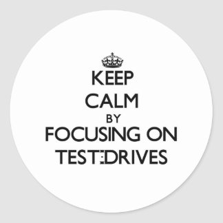 Keep Calm by focusing on Test-Drives Round Stickers