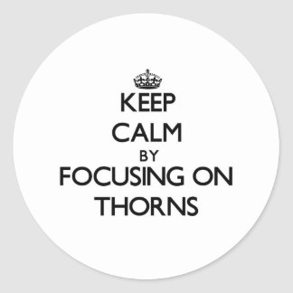 Keep Calm by focusing on Thorns Classic Round Sticker