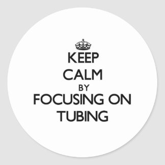 Keep Calm by focusing on Tubing Classic Round Sticker