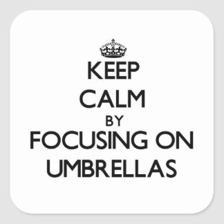 Keep Calm by focusing on Umbrellas Square Sticker