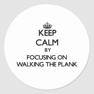 Keep Calm by focusing on Walking The Plank Round Sticker