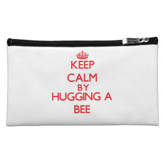 Keep calm by hugging a Bee Cosmetics Bags