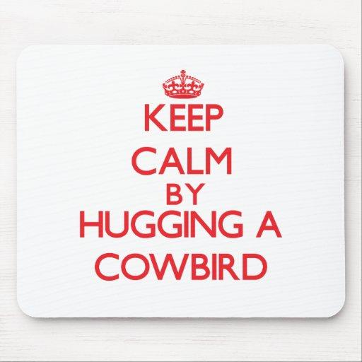 Keep calm by hugging a Cowbird Mousepads