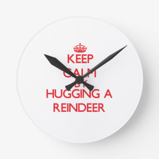 Keep calm by hugging a Reindeer Round Wall Clock