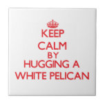 Keep calm by hugging a White Pelican Small Square Tile