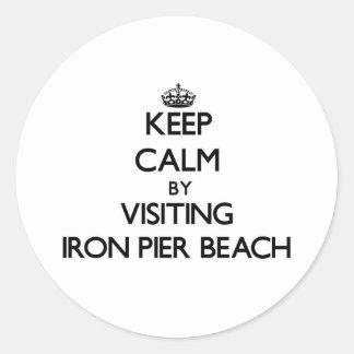 Keep calm by visiting Iron Pier Beach New York Round Sticker