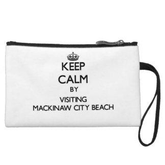 Keep calm by visiting Mackinaw City Beach Michigan Wristlet Clutch
