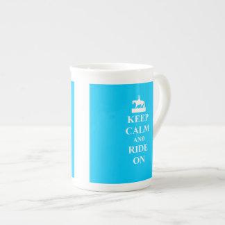 Keep calm & ride on (light blue) tea cup