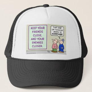 Keep friends close and enemies closer. trucker hat