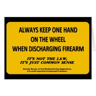 Keep one hand on the wheel when firing your gun greeting card