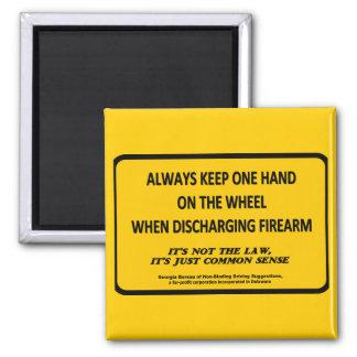 Keep one hand on the wheel when firing your gun fridge magnet