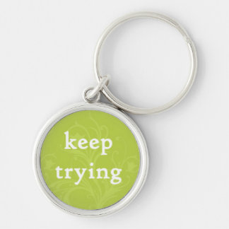 Keep Trying on a Green Background Keychain