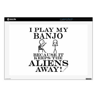"Keeps Aliens Away Banjo 17"" Laptop Skins"