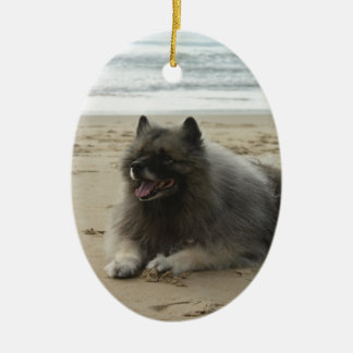 keeshond on beach.png ceramic ornament