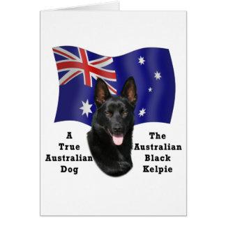 Kelpie negro australiano con la bandera felicitacion