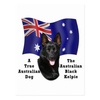 Kelpie negro australiano con la bandera postal