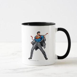 Kent changes into Superman Mug
