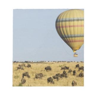 Kenya, Masai Mara. Tourists ride hot air balloon Note Pad
