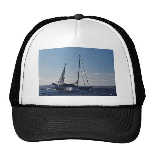 Ketch motoring into headwind. trucker hat