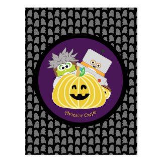 Kevin and Jasper behind a Pumpkin Postcard