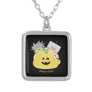 Kevin and Jasper behind a Pumpkin Square Pendant Necklace