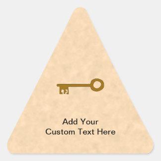 Key. Brown Key on Parchment Effect. Triangle Sticker