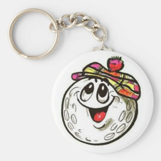 Key chain with a cartoon golf ball face