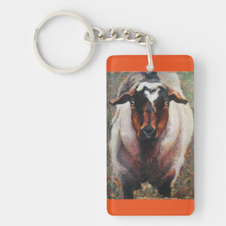 Key chain with goat in rust and cream